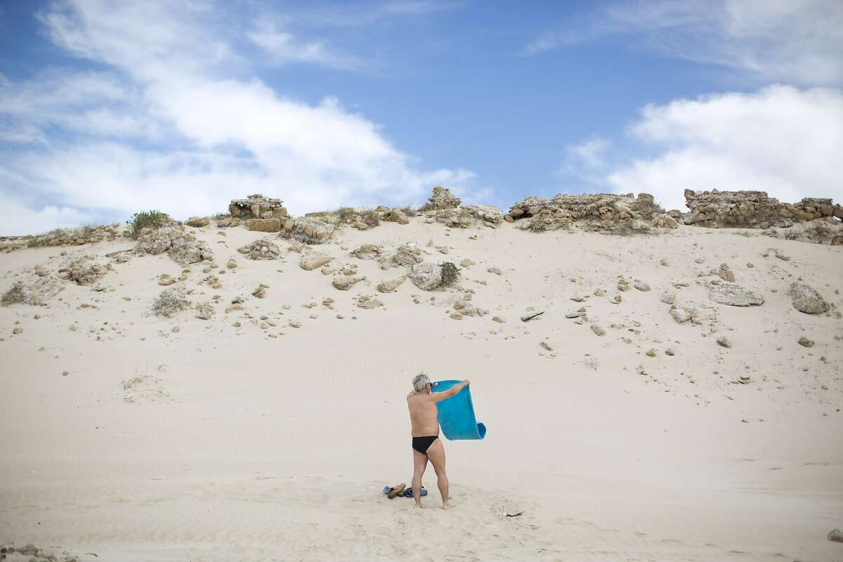 WANT THE BEACH TO YOURSELF? Be over 50 and wear a Speedo. (Mediterranean Sea coast in Caesarea, northern Israel.)