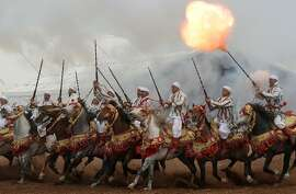"TOPSHOTS  Moroccan horsemen perform during the 7th edition of the ""Salon du Cheval"" in the port city of El Jadida on October 21, 2014. AFP PHOTO / FADEL SENNAFADEL SENNA/AFP/Getty Images"