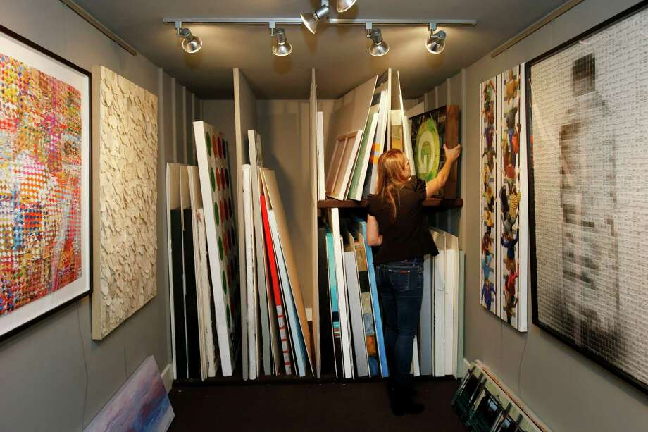 Stephanie Breitbard looks over stored art pieces in the smaller outside gallery of her Mill Valley home. Photo: Brant Ward / The Chronicle / ONLINE_YES