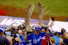 KANSAS CITY, MO - OCTOBER 21:  A fan holding moose antlers is seen during Game One of the 2014 World Series at Kauffman Stadium on October 21, 2014 in Kansas City, Missouri.  (Photo by Ed Zurga/Getty Images) ***BESTPIX***