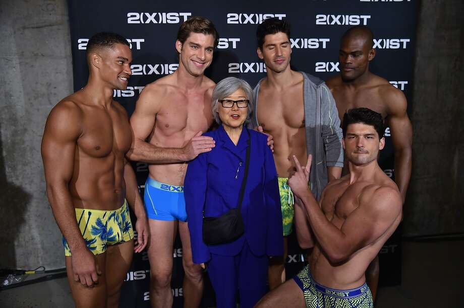 DREAMS DO COME TRUE! A guest poses with hunky models backstage during 2(X)IST Spring/Summer 2015 Runway Show in New York City. Photo: Mike Coppola, Getty Images