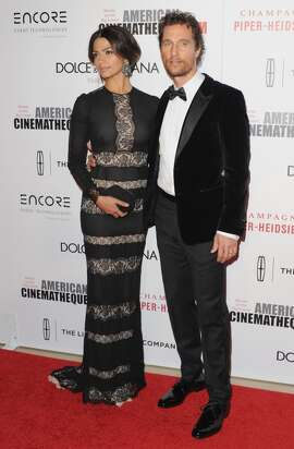Camila Alves McConaughey and husband actor Matthew McConaughey arrive at the 28th American Cinematheque Award Honoring Matthew McConaughey at The Beverly Hilton Hotel on October 21, 2014 in Beverly Hills, Calif.