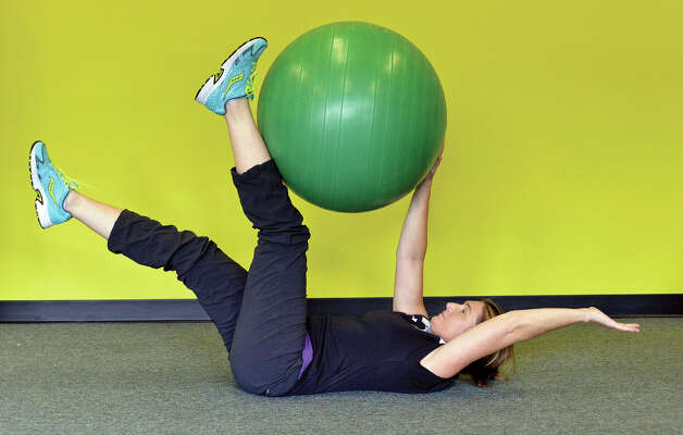 3. Repeat 10 to 15 times per side completing the exercise slowly. If your back begins to arc too much off the floor or you feel any pressure in your low back, reduce how far you lower your legs. Photo: John Carl D'Annibale / 518Life / 518Life magazine