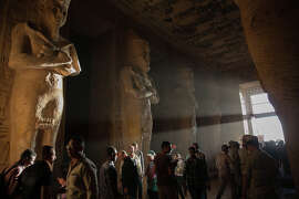 Domestic and foreign tourists come to the Abu Simbel temples to see the sunbeams, lighting up the statues of King Ramesses II and other 'gods' twice a year in Aswan, Egypt on October 22, 2014. It's believed that this occurrence commemorates Ramses IIs ascension to the throne, 22nd February, and his birthday, 22nd October. Also it's believed that agricultural season starts on October 22, and harvest season starts in ancient Egypt.