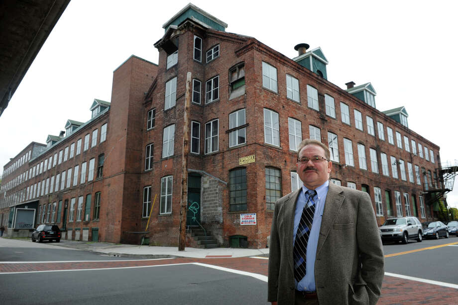 Developer John Guedes stands in front of the former SpongeX property in downtown Shelton, Conn. Oct. 22, 2014. Guedes developed the former factory building into loft condominiums, and wants to now develop the area behind Huntington Congregational Church. Photo: Ned Gerard / Connecticut Post