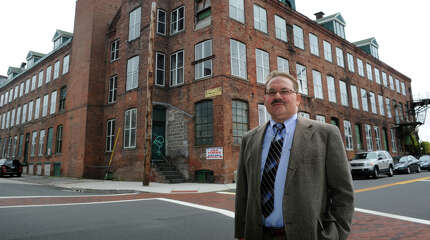 Developer John Guedes stands in front of the former SpongeX property in downtown Shelton, Conn. Oct. 22, 2014. Guedes is moving forward with plans to turn the former factory building into loft condominiums.