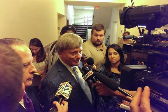 Rusty Hardin, defense attorney for Adrian Peterson in his child abuse case, speaks to reporters in Conroe on Wednesday after a court denied a prosecution motion to remove a Montgomery County judge from the case for alleged bias against the district attorney's office.