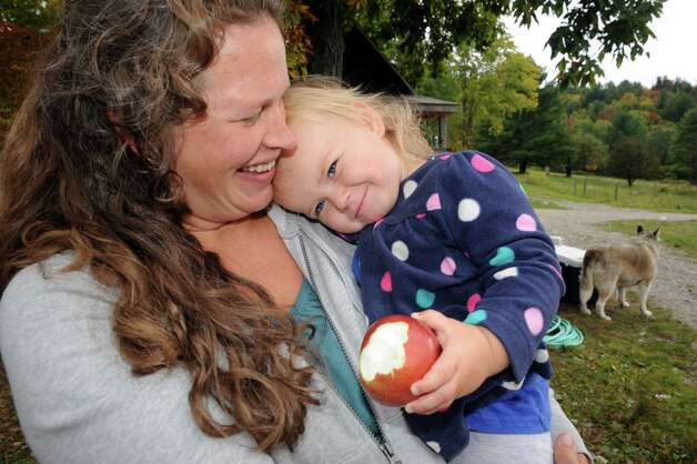 Eliza Winters and her 18-month old daughter Mathilda on their family farm Hill Hollow Farm on Thursday Sept. 25, 2014 in Petersburgh, N.Y.  (Michael P. Farrell/Times Union) Photo: Michael P. Farrell / 00028744A