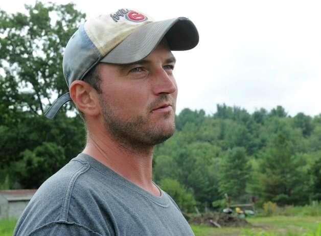 Nathan Winters looks over his crops at Hill Hollow Farm on Thursday, Aug, 1, 2013 in Petersburg, N.Y.  (Lori Van Buren / Times Union) ORG XMIT: MER2013080512160814 Photo: Lori Van Buren / 00023341A