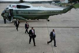 Secret Service agents accompany the president from Marine One to Air Force One at Andrews Air Force Base on Oct. 1.  in Maryland, Oct. 1, 2014. Julia Pierson resigned as director of the Secret Service on Wednesday, after repeated breaches of security left lawmakers — apparently including Obama — convinced that new leadership was required. (Doug Mills/The New York Times)