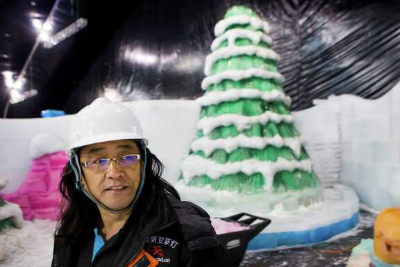 FOR FUTURE STAR STORY BY SYD. DO NOT PUBLISH IN PRINT OR ONLINE UNTIL THEN. JCK Ice sculptor Qiu GuangHui walks past an icy Christmas tree while working on the construction of Ice Land: Ice Sculptures with SpongeBob SquarePants at Moody Gardens on Thursday, Oct. 16, 2014, in Galveston. The icy display, using 900 tons of ice built by Chinese ice sculptors led by Qiu GuangHui, opens November 15. It is touted as the only holiday ice exhibition on the Gulf Coast. ( Brett Coomer / Houston Chronicle )FOR FUTURE STAR STORY BY SYD. DO NOT PUBLISH IN PRINT OR ONLINE UNTIL THEN. JCK Ice sculptor Qiu GuangHui walks past an icy Christmas tree while working on the construction of Ice Land: Ice Sculptures with SpongeBob SquarePants at Moody Gardens on Thursday, Oct. 16, 2014, in Galveston. The icy display, using 900 tons of ice built by Chinese ice sculptors led by Qiu GuangHui, opens November 15. It is touted as the only holiday ice exhibition on the Gulf Coast. ( Brett Coomer / Houston Chronicle )