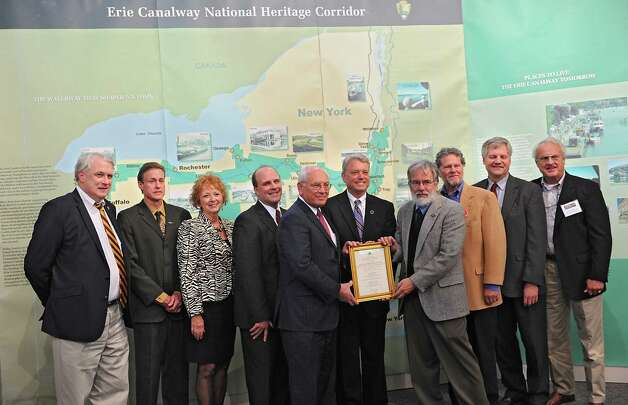 Officials and supporters stand with the certificate from NYS Office of Parks, Recreation and Historic Preservation during a dedication ceremony in which the New York State Barge Canal is listed on the National Register of Historic Places at the Erie Canalway National Heritage Corridor, Visitor Center Wednesday, Oct. 22, 2014 in Waterford, N.Y.  (Lori Van Buren / Times Union) Photo: Lori Van Buren / 00029089A