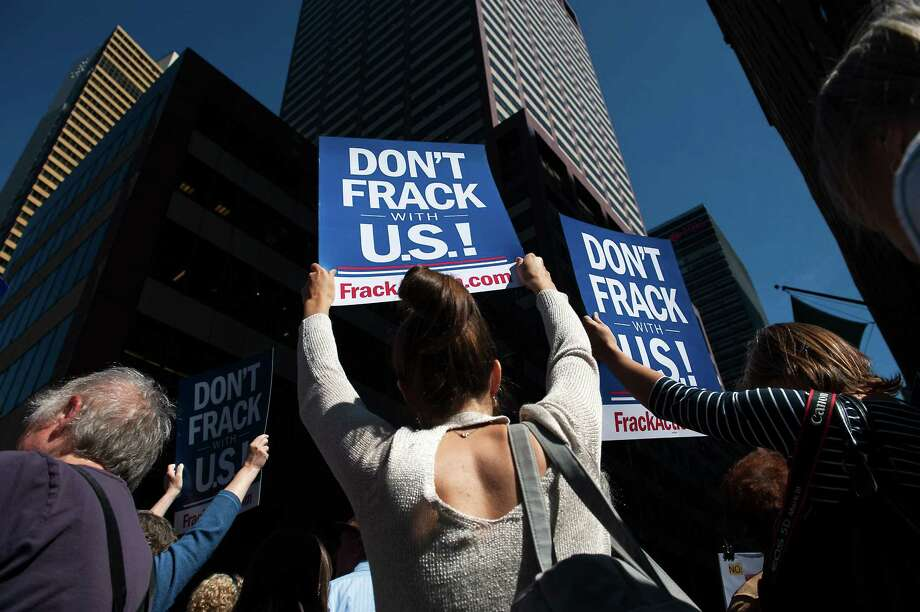 NEW YORK, NY - SEPTEMBER 23:  Anti-fracking demonstrators protest on 51st Street and 7th Avenue as President Obama arrives at the Sheraton Hotel, at 52nd Street, on September 23, 2014 in New York City. As the UN General Assembly begins, demonstrators have taken the opportunity to protest in front of the 140 heads of state expected to be in New York, NY. (Photo by Bryan Thomas/Getty Images) ORG XMIT: 514627137 Photo: Bryan Thomas / 2014 Getty Images