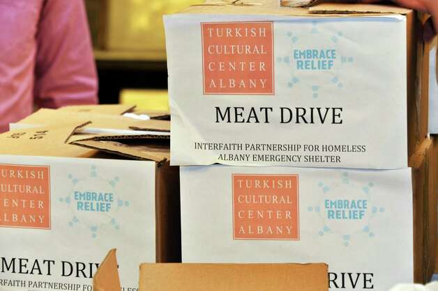 Albany Emergency Center receives 100 pounds of packaged beef cutlets from Turkish Cultural Center Albany for their Meat Drive, dedicated to the Feast of Sacrifice (Eid al Adha) in partnership with Embrace Relief Foundation Wednesday Oct. 22, 2014, in Albany, NY.  (John Carl D'Annibale / Times Union) Photo: John Carl D'Annibale / 00029161A