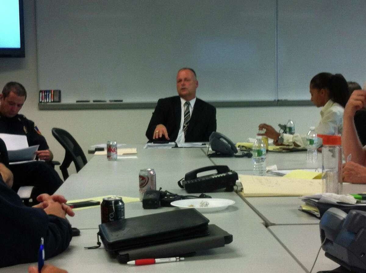 Public Safety, Health and Welfare Director Ted Jankowski leads a weekly meeting of public safety officials Wednesday that focused on the status of procedures to handle a suspected case of ebola virus.