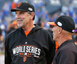 Giants' manager Bruce Bochy (left), chatting with third base coach Tim Flannery, is a finalist for NL Manager of the Year.
