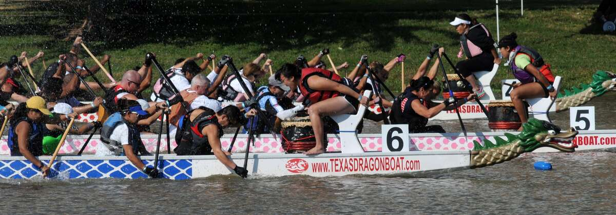 The DUC Delite (6), Team Skittles (5), and All Hands Abreast (4) teams leave the starting line during their Round 2 race at the 11th annual Gulf Coast International Dragon Boat Regatta at Brooks Lake at Fluor in Sugar Land on Oct. 19.