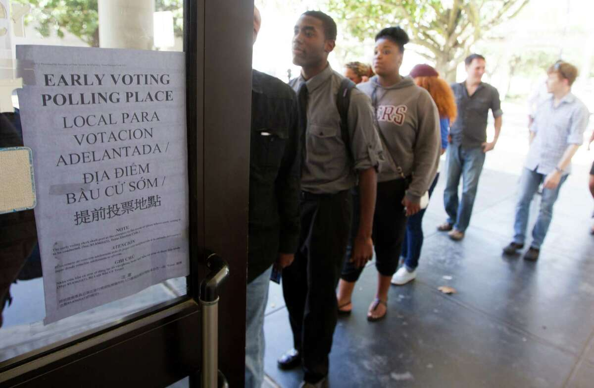 Students from Texas Southern University stand in line at a early voting location after attending a rally encouraging them to get out and vote on Tuesday, Oct. 21, 2014, in Houston. (J. Patric Schneider / For the Chronicle )