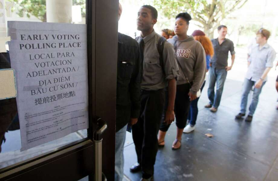 Students from Texas Southern University stand in line at a early voting location after attending a rally encouraging them to get out and vote on Tuesday, Oct. 21, 2014, in Houston.   (J. Patric Schneider / For the Chronicle ) Photo: J. Patric Schneider, Freelance / © 2014 Houston Chronicle