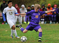 Westhill's Jake Atkinson shoots on the Trinity Catholic goal during their soccer game at Trinity Catholic High School in Stamford, Conn., on Wednesday, Oct. 22, 2014. Westhill won, 4-0.