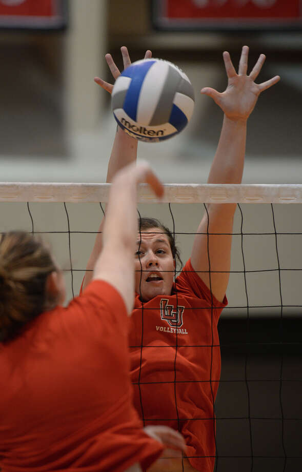 Lamar's Autumn Taylor blocks the ball during practice at McDonald Gym on Wednesday. Photo taken Wednesday, October 22, 2014 Guiseppe Barranco/@spotnewsshooter Photo: Guiseppe Barranco, Photo Editor