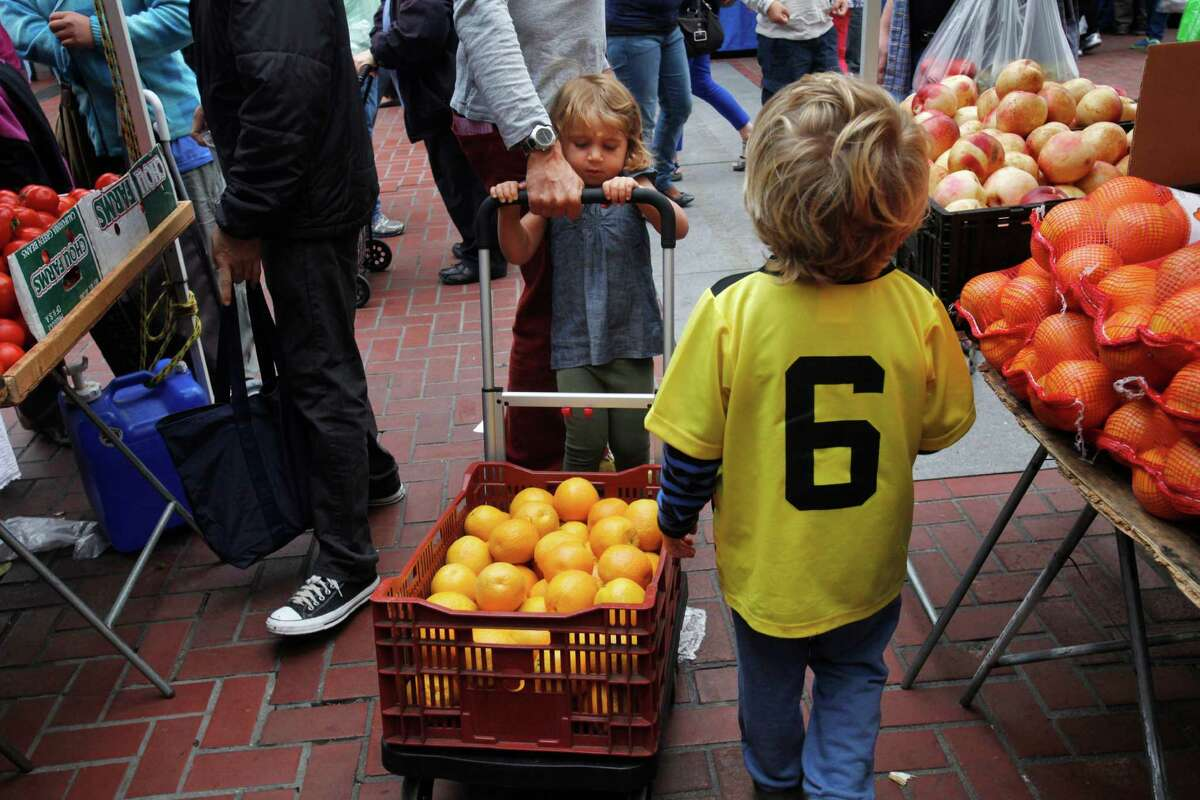 Many families make the shopping at local farmers' markets a weekly tradition.