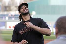 Michael Morse shares a smile during warm ups as the San Francisco Giants prepare to take on the Kansas City Royals in game two of the World Series at Kauffman Stadium in Kansas City, Mo., on Wednesday Oct. 22, 2014.