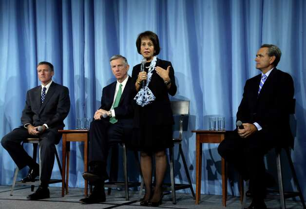 University of North Carolina Chancellor Carol Folt, center, addresses the media following a special joint meeting of the University of North Carolina Board of Governors and the UNC-Chapel Hill Board of Trustees in Chapel Hill, N.C., Wednesday, Oct. 22, 2014. From left are, Kenneth Wainstein, lead investigator, University President Tom Ross and Athletic Director Bubba Cunningham at right. (AP Photo/Gerry Broome) ORG XMIT: NCGB122 Photo: Gerry Broome / AP