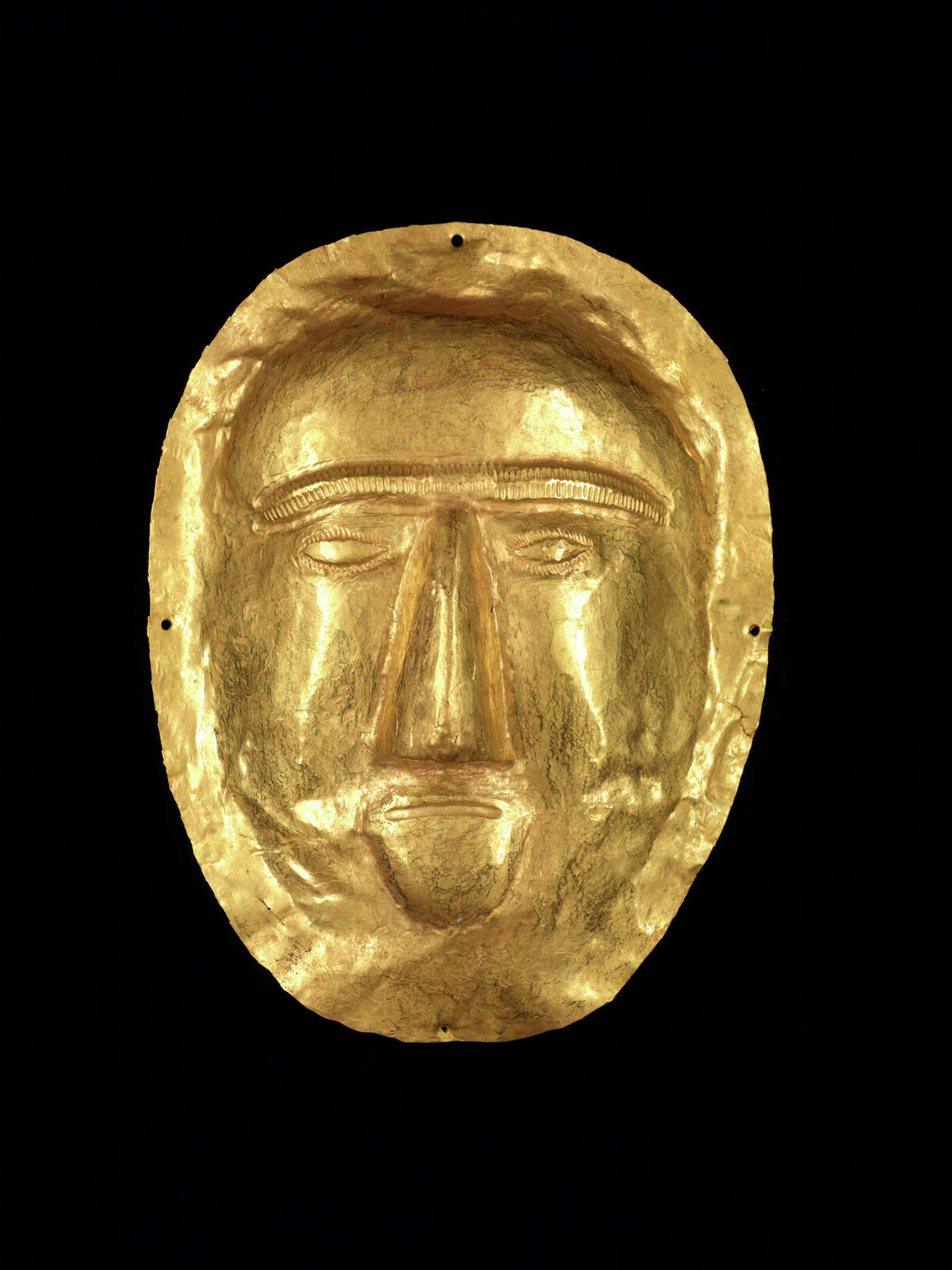 """A funerary mask from Thaj, Saudi Arabia, is part of the """"Roads of Arabia"""" exhibition at the Asian Art Museum."""