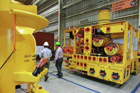 FMC Technologies says it's seeing demand for greater standardization in subsea trees, the underwater well control systems shown at its facility in Houston. ( Melissa Phillip / Houston Chronicle )