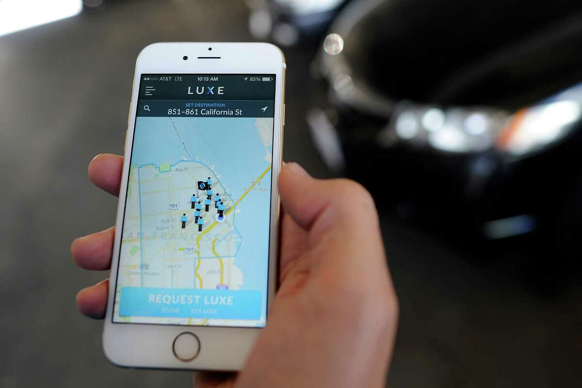Valet Josh Dunlap show the iPhone app for on-demand valet service Luxe Valet in San Francisco on Oct. 22, 2014. Luxe Valet allows customers to summon a valet with an iPhone app, and the valet meets them wherever they want and drives the car to a secure lot.