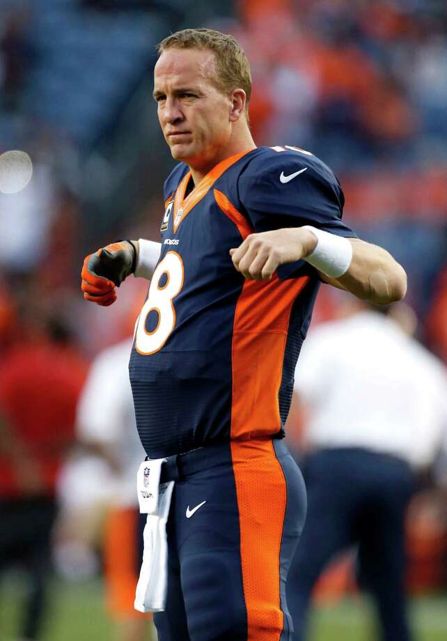 Denver Broncos quarterback Peyton Manning warms up prior to an NFL football game against the San Francisco 49ers, Sunday, Oct. 19, 2014, in Denver. (AP Photo/Brennan Linsley) ORG XMIT: COMY114 Photo: Brennan Linsley / AP