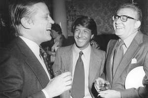 """At the Kennedy Center reception before the premiere of """"All the President's Men."""" Dustin Hoffman tells a very funny, dirty joke to Ben Bradlee and Harry Rosenfeld, who appreciated the actor's sense of humor. (The Washington Post)"""