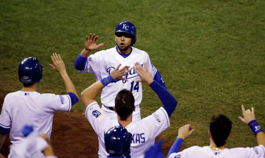 Kansas City Royals' Omar Infante celebrates with teammates after scoring a run during the second inning of Game 2 of baseball's World Series against the San Francisco Giants Wednesday, Oct. 22, 2014, in Kansas City, Mo. (AP Photo/Jeff Roberson) Photo: Jeff Roberson, Associated Press / AP