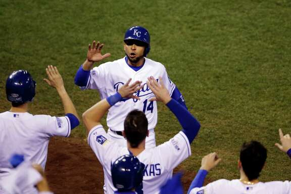 Kansas City Royals' Omar Infante celebrates with teammates after scoring a run during the second inning of Game 2 of baseball's World Series against the San Francisco Giants Wednesday, Oct. 22, 2014, in Kansas City, Mo. (AP Photo/Jeff Roberson)