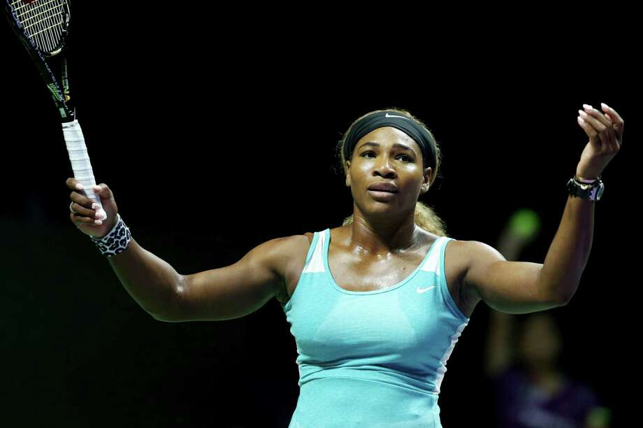 Serena Williams of the U.S. reacts during her singles match against Romania's Simona Halep at the WTA tennis finals in Singapore, Wednesday, Oct. 22, 2014. (AP Photo/Mark Baker) ORG XMIT: XMB113 Photo: Mark Baker / AP