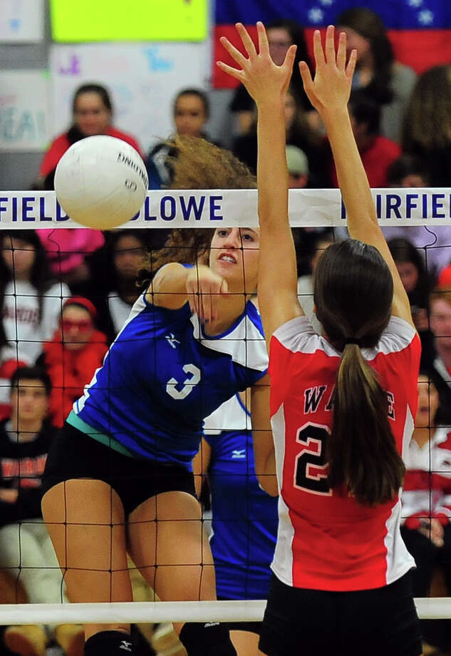 Fairfield Ludlowe's Keki Cardenas spikes the ball past Fairfield Warde's Nicole Vacarella, during girls volleyball action in Fairfield, Conn. on Wednesday October 22, 2014. Photo: Christian Abraham / Connecticut Post