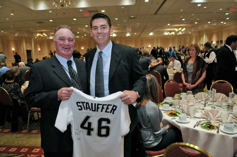 San Diego Padres pitcher Tim Stauffer, right,  poses for a picture with his South Troy Dodgers coach George Rogers, before Tim was  inducted into the Capital District Baseball Hall of Fame during a dinner and ceremony at the Crowne Plaza on Sunday evening Nov. 6, 2011 in Albany, NY. Rogers is the founder, owner and coach of the Dodgers. He coached Stauffer in 1999-2000. Stauffer gave Rogers the signed jersey. Stauffer's mother Becky is standing at right. (Philip Kamrass / Times Union ) Photo: Philip Kamrass / 00015241A