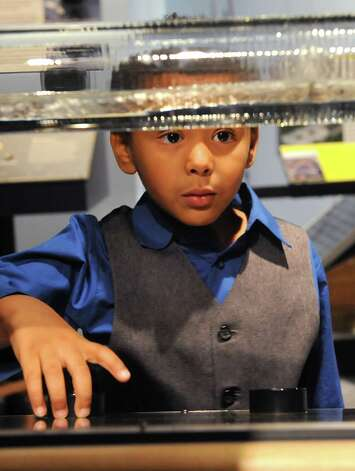 Antonio Westerman, 5, of Schenectady turns a knob and watches as invisible sound waves shape a visible surface at the miSci on Wednesday, Oct. 22, 2014 in Schenectady, N.Y. Kids experienced hands-on STEM: electricity demos, nanotechnology activities, planetarium show and interactive exhibits at miSci in partnership with Afterschool Works! (Lori Van Buren / Times Union) Photo: Lori Van Buren / 00029147A
