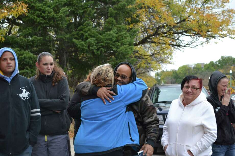 Nathan Milligan, father of Vanessa Milligan, hugs Shannon Williamson, Vanessa's aunt, outside the Troy Police Department Wednesday, Oct. 22, 2014, after an arrest was made in the April death of Vanessa and her unborn daughter. (Keshia Clukey/ Times Union)