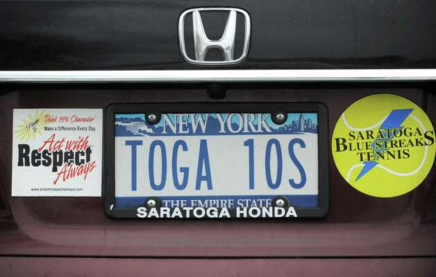A license plate shows support for the Saratoga Springs tennis team outside the Section II girls' tennis singles and doubles finals at Sportime on Wednesday, Oct. 22, 2014 in Schenectady, N.Y.  (Lori Van Buren / Times Union) Photo: Lori Van Buren / 00029090A