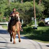 Darius Robinson, 11, rides his horse in Acres Homes neighborhood on Tuesday, Oct. 21, 2014, in Houston. One man is dead and another is in the hospital after a crash involving an SUV and a horse Sunday night in northwest Houston.
