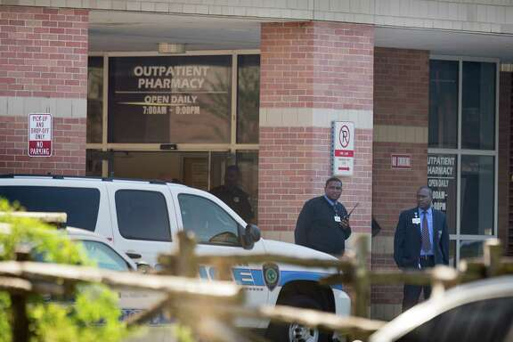 Investigators work at Ben Taub General Hospital after a shooting Wednesday in the outpatient pharmacy. Two employees died; no one else was injured, authorities said.