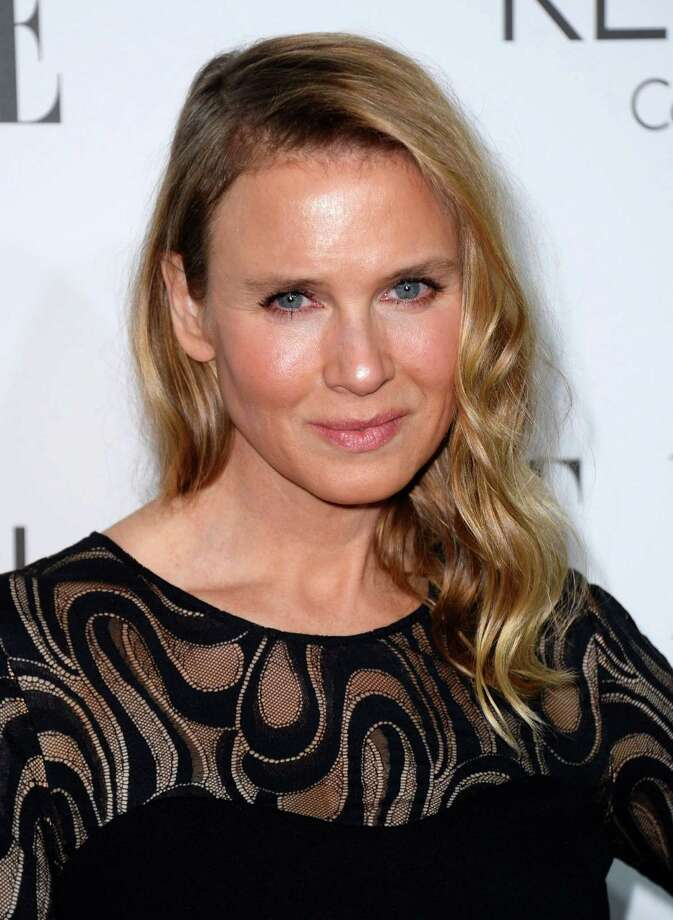 "FILE - In this Oct. 20, 2014 file photo, actress Renee Zellweger arrives at ELLE's 21st annual Women In Hollywood Awards in Los Angeles. Zellweger says she looks different because she's ""living a different, happy, more fulfilling life."" The 45-year-old Oscar winner issued a statement to People magazine late Tuesday, Oct. 21, 2014, after she became a trending topic on Twitter, with many fans claiming the actress had become ""unrecognizable."" Her appearance at a Hollywood event earlier this week sparked widespread Internet chatter. (Photo by Jordan Strauss/Invision/AP, File) ORG XMIT: NYET319 Photo: Jordan Strauss / Invision"