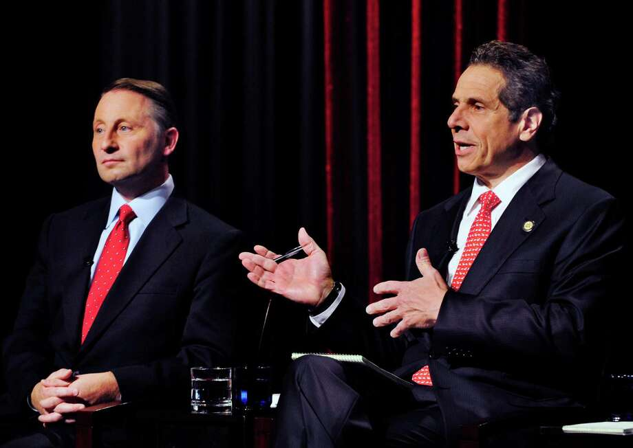 New York State Gubernatorial Candidate Republican candidate Rob Astorino, left, listens to the response of Democratic incumbent Andrew Cuomo, about fracking during a debate Wednesday, Oct., 22, 2014, in  Buffalo , N.Y. (AP Photo/Gary Wiepert) ORG XMIT: NYGW105 Photo: Gary Wiepert / FR170498 AP