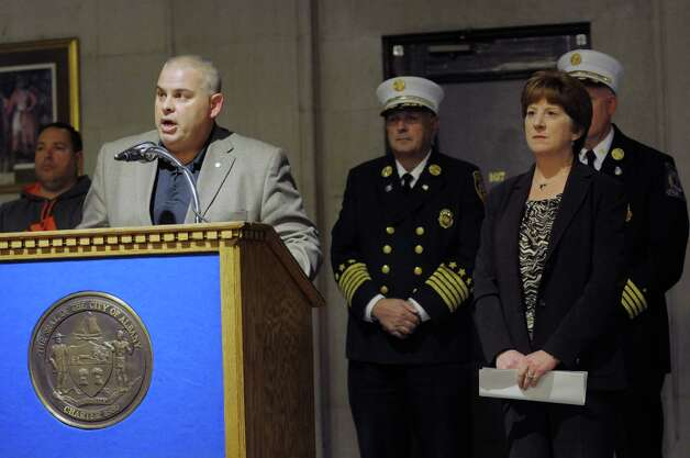 Robert Powers, left, president of the Albany Firefighters union, along with Mayor Kathy Sheehan, take part in a press conference at City Hall on Wednesday, Oct. 22, 2014, in Albany, N.Y.  The press event was held to announce that the Mayor had struck a tentative deal with the city's firefighters union to keep Ladder No. 1 in the South End open.   (Paul Buckowski / Times Union) Photo: Paul Buckowski / 00029177A