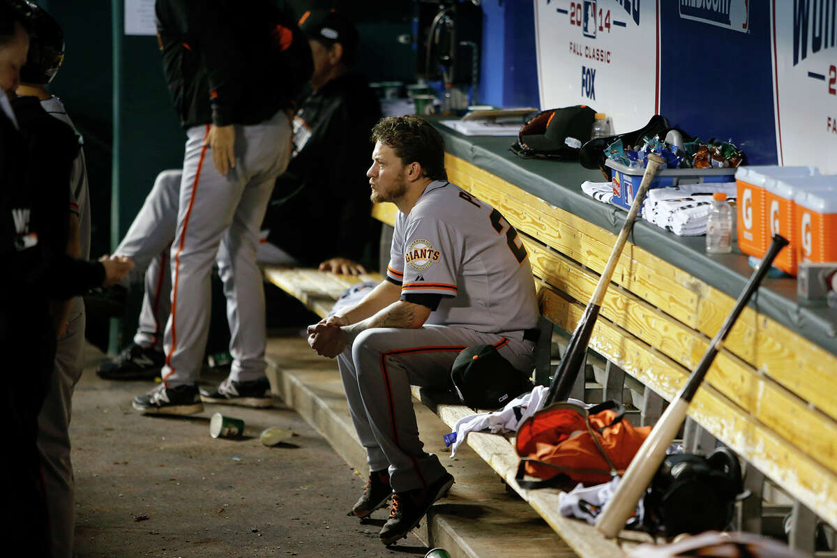 Giants Jake Peavy watches the game in the sixth inning during Game 2 of the World Series at Kauffman Stadium on Wednesday, Oct. 22, 2014 in Kansas City, Mo.