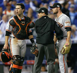 Giants Hunter Strickland is held back by an umpire in the sixth inning during Game 2 of the World Series at Kauffman Stadium on Wednesday, Oct. 22, 2014 in Kansas City, Mo.