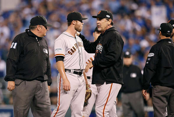 Giants manager Bruce Bochy tries to calm Hunter Strickland in the sixth inning during Game 2 of the World Series at Kauffman Stadium on Wednesday, Oct. 22, 2014 in Kansas City, Mo.
