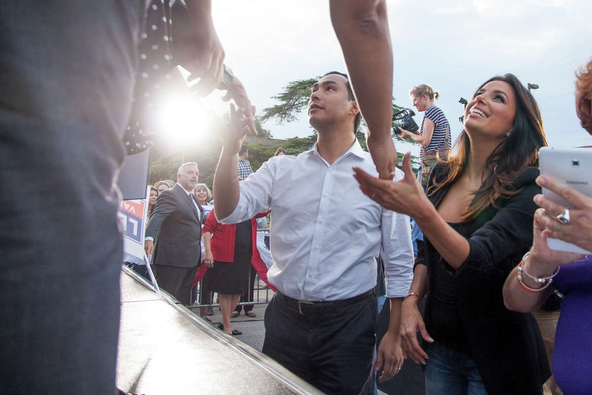 Congressman Joaquin Castro and Eva Longoria greet supporters Wednesday October 22, 2014 during a rally held for Senator Leticia Van de Putte, who is running for Lt. Governor, in San Pedro Park. The rally is launching a statewide